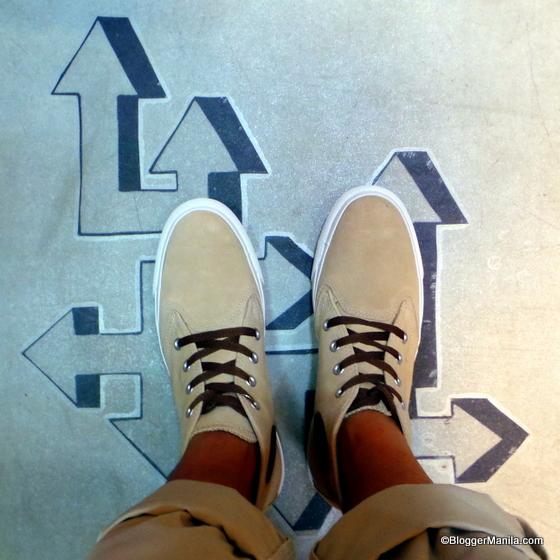 A Pair of Feet on Chuck Taylor All Star Berkshire Mid